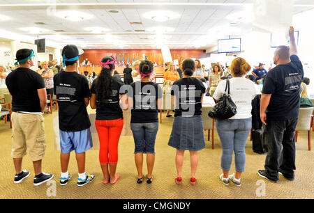 AUGUST 6, 2012 - Mineola, New York, U.S. - At Nassau County Legislature meeting, many in audience turn away from - Stock Photo