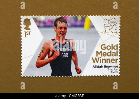 UK Wednesday 8 August 2012. Stamp to honour gold medal winner Alistair Brownlee in the Triathlon Men's event. Stamp - Stock Photo