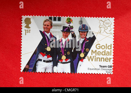 UK Wednesday 8 August 2012. Stamp to honour gold medal winner Team GB in Equestrian Dressage Team event. Stamp purchased - Stock Photo