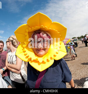 8 Aug 2012 A woman wearing a bright yellow daffodil headpiece at the National Eisteddfod of Wales .  This annual - Stock Photo