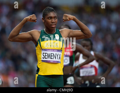 Aug. 11, 2012 - London, England, United Kingdom - Caster Semenya (RSA) flexes her arms after winning the Silver - Stock Photo