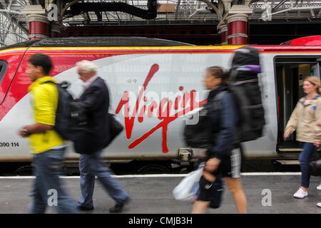 Passengers alighting from a Virgin Train service in Liverpool, UK on Wednesday August 15th 2012. Virgin Trains who - Stock Photo