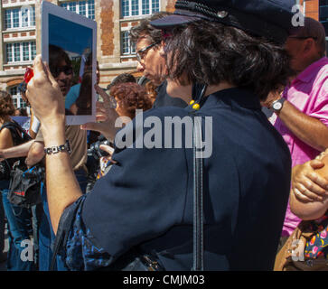 Paris, France, Woman Taking Pictures, Photos with Ipad Tablet in Crowd of People on Street - Stock Photo
