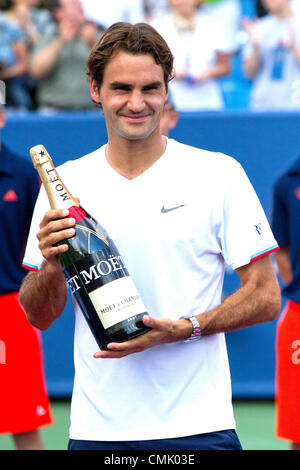 19 August 2012: Roger Federer (SUI) holds his commemorative bottle after the Men's Singles Finals where Roger Federer - Stock Photo