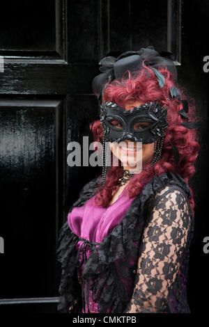 Whitby, Yorkshire, UK 2nd October, 2013. Trinity Stark, 13  wearing fancy dress, a mask and red wig at the UK'S - Stock Photo