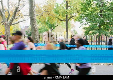 New York, USA. 03rd Nov, 2013. Runners nearing mile 12 in ING New York City Marathon November 3, 2013 © Kristin - Stock Photo