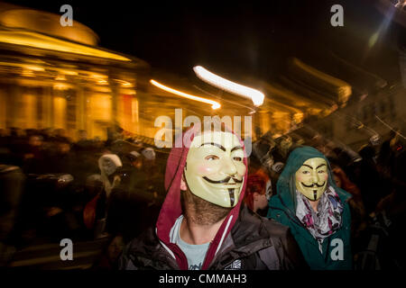 London, UK. 5th November 2013. 'Million Mask March' protest in London Credit:  Guy Corbishley/Alamy Live News - Stock Photo