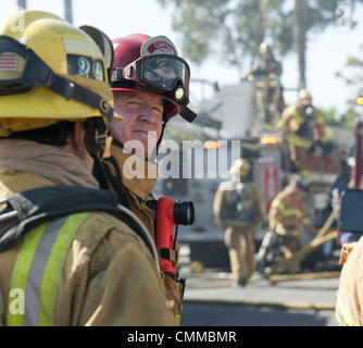 Dana Point, California, USA. 5th Nov, 2013. OCFA Firefighters prepare to carry gear across a ladder deployed off - Stock Photo