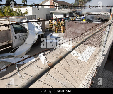 Dana Point, California, USA. 5th Nov, 2013. The remains of a garage door could be seen strewn across a truck from - Stock Photo
