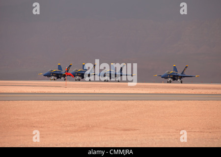 Navy Blue Angel demonstration fighter jets fly by in close formation during takeoff on runway video. Yellow and - Stock Photo