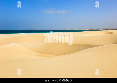 View to sea across large sand dunes on pristine sandy beach of Praia de Chaves, Rabil, Boa Vista, Cape Verde Islands - Stock Photo