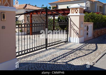 Wrought iron gates to private residence - Stock Photo