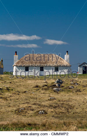 Traditional thatched Cottage at Howmore (Tobha Mòr) , Isle of South Uist, Outer Hebrides Scotland UK - Stock Photo