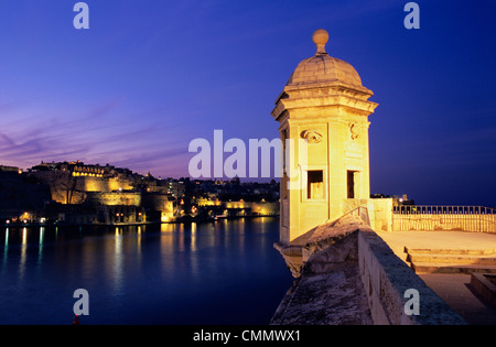 Vedette watchtower and view across the Grand Harbour to Valletta at dusk, Senglea, Malta, Mediterranean, Europe - Stock Photo