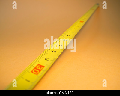 Metal measuring tape marked in centimeters - Stock Photo