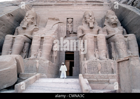 Four colossal statues of Ramesses II guard the entrance to his famous rock-cut temple at Abu Simbel built in Nubia, - Stock Photo