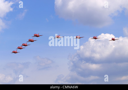 Red Arrows aerobatic team formation flypast at RAF Fairford, UK - Stock Photo