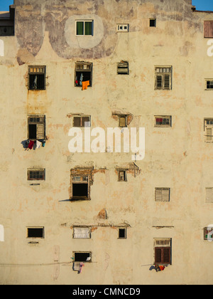 Pattern created by windows on the side of decrepit apartment building at sunset in Havana, Cuba. - Stock Photo