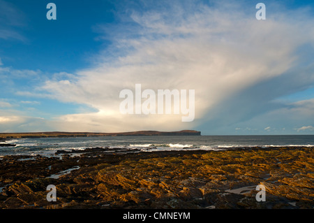 Cumulonimbus shower cloud over Dunnet Head  and the Pentland Firth, Caithness, Scotland, UK. - Stock Photo