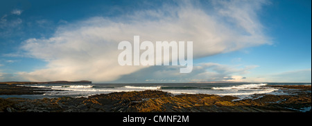 Cumulonimbus shower cloud over the Pentland Firth, Caithness, Scotland, UK. Dunnet Head on left and Hoy, Orkney - Stock Photo