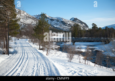 Cross-country tracks following Otra river in Hovden, a skiing resort in south Norway - Stock Photo