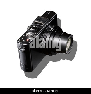 A black camera with shadow on a white background. - Stock Photo