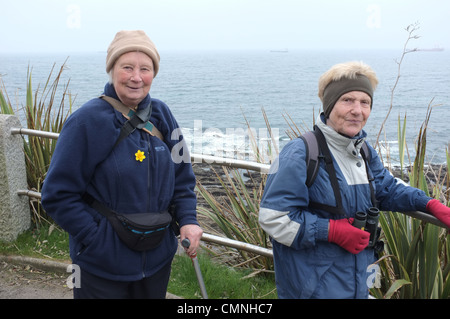 Two old ladies walking along the front in Falmouth, UK - Stock Photo
