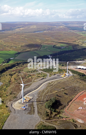 Aerial view of two wind turbines under construction - Stock Photo