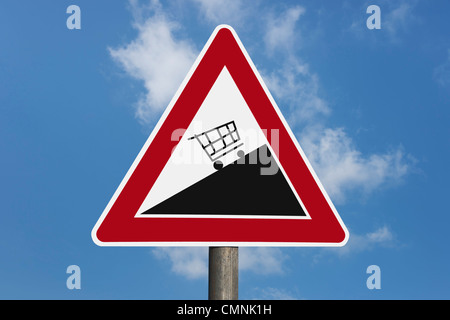 Detail photo of a danger sign 'Upward gradient' with a shopping cart, background sky - Stock Photo