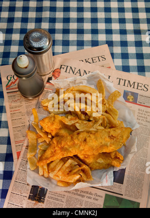 Traditional fish and chips served on the Financial Times - Stock Photo