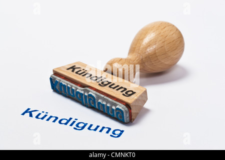 Detailansicht eines Stempels mit der Aufschrift Kündigung | Detail photo of a stamp with inscription in German cancellation - Stock Photo