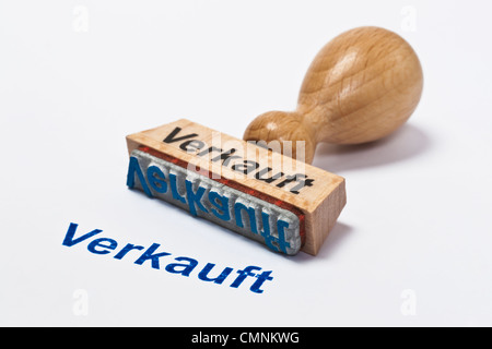 Detailansicht eines Stempels mit der Aufschrift Verkauft | Detail photo of a stamp with inscription in German sold - Stock Photo