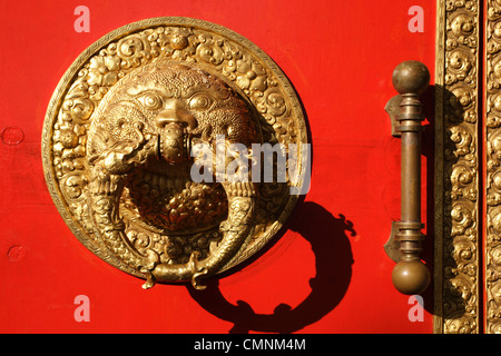The ornate door knocker of Namdroling Monastery, which hosts the famous Golden Buddha Temple at Kushalnagar, Karnataka, - Stock Photo