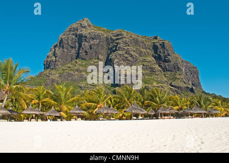 Le Morne Brabant  mountain towering over the beach in front of the hotel Dinarobin,  on the Indian Ocean island - Stock Photo