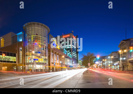 MTS Centre Arena and traffic at night on Portage Avenue,  downtown Winnipeg, Manitoba - Stock Photo