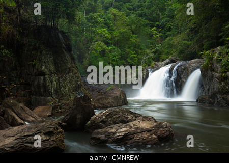 Waterfall at Crystal Cascades - a popular freshwater swimming hole near Cairns, Queensland, Australia - Stock Photo