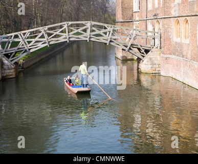 People punting on the River Cam by the Mathematical Bridge, Cambridge, England - Stock Photo