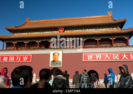 Tourists discretely scrutinzed by plaincloth security personnel at theTiananmen Gate, entrance to the Forbidden - Stock Photo