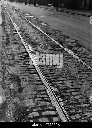 Tramlines, Willenhall Road, Wolverhampton, Early 20th cent. Tramlines showing some damage (foreground) on the partly - Stock Photo