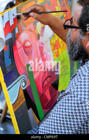 Chile,Santiago,Plaza de Armas,main public square,plein air artist,art,creativity,painting,canvas,paintbrush,easel,Hispanic man men male adult adults,a