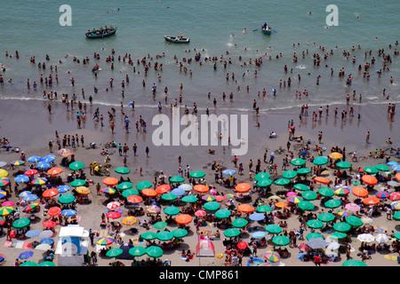 Lima Peru Barranco District Malecon Circuito de playas Playa los Yuyos Pacific Ocean coast aerial view beach crowd - Stock Photo