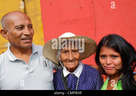 Lima Peru Barranco District Avenida Miguel Grau street scene pedestrian Hispanic woman man girl teen three generations - Stock Photo