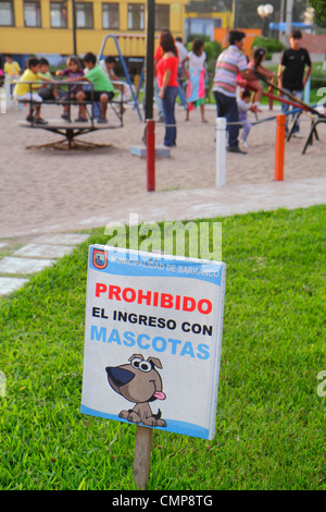 Lima Peru Barranco District Avenida Miguel Grau Parque Municipal public park playground grass sign information Spanish - Stock Photo