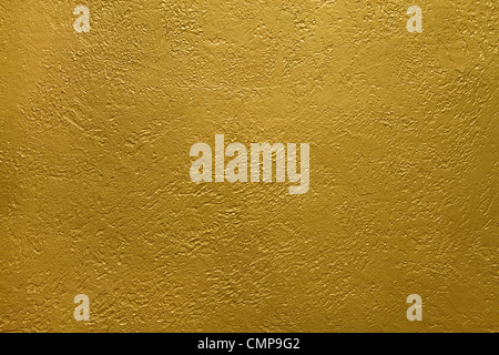 texture of a cement wall covered with gold paint - Stock Photo