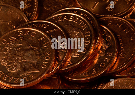 Close detail of UK one pence (1p) coin, single pennies. - Stock Photo