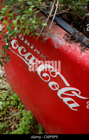 Vintage Coca-Cola cooler used as planter photographed in Gruene, Texas. - Stock Photo