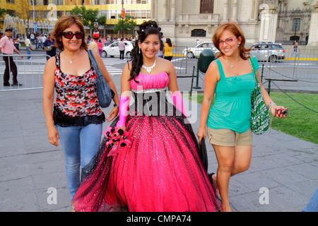 Lima Peru Plaza de Armas public square park teen Quinceañera quince Hispanic girl woman mother daughter gown formal - Stock Photo