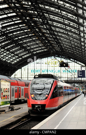 Deutsche Bahn DB high speed German intercity passenger train standing at platform in Cologne railway station, Germany - Stock Photo