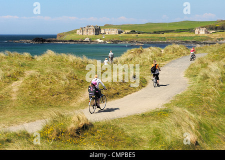 Cycling the Runkerry Trail to the Giants Causeway at Portballintrae strand near Bushmills and Portrush, Northern - Stock Photo