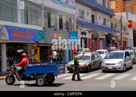 Peru, Tacna, Calle San Martin, commercial district, storefront, street scene, traffic, stopped, tricycle, cart, - Stock Photo